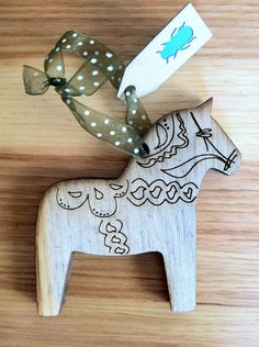 Swedish Dala Horse Christmas Ornament  (Colorado Beetle Kill Pine Wood). $10.00, via Etsy. @Jolly Green Giant Can you make this for me?