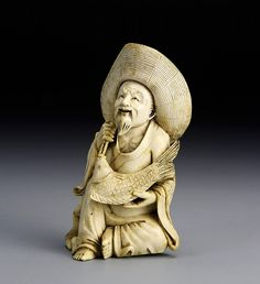 Japan, 19th C., carved ivory figure of a man holding a fish, wearing a large brimmed hat. Height 5 in.