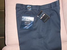 """Mens Slacks By Izod Madison Flat Front Chino Casual Pant 32 X 32 New with all Tags.  Flat front chino casual pant. Sport flex waistband has up to 1.5"""" of invisible stretch. Features a Metrix Flex. 100% Cotton. Machine wash. Available in Navy. Waist sizes 32; Length sizes 32"""