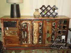 """Reclaimed wood, wine buffet in a distressed array of colors. Made of solid sheeshum wood, this piece has storage space for 10 bottles down the right side and three drawers down the left side. 76""""long x 18""""deep x 36""""high. Arrived: Friday November 25th, 2016"""
