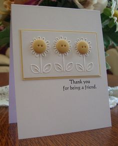 Yellow and white flowers are sure to brighten anyone's day!  The white embossed flowers have sunshiney yellow button centers, bordered with a sliver of yellow paper.  Handmade thank you card