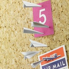 Paper Airplane Push Pins are the perfect mix of childish appeal and adult function.