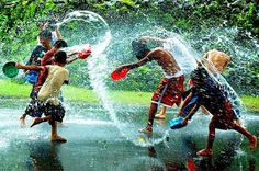 children playing under the rain