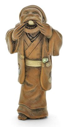 japaneseaesthetics:「Kokeisai山椒、後期初頭/ 19 20世紀、日本の男の象眼細工の木製の根付。 立ち、フロッピー帽子を身に着けているとローブをベルト付き、象眼細工のメダリオンで、前傾姿勢とに両手で彼の口を開いて保持します...