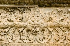 Image from http://previews.123rf.com/images/basphoto/basphoto1206/basphoto120600019/14240230-Ancient-Khmer-stone-lintel-carved-with-images-of-devatas-or-gods-riding-on-elephants-Bakong-Temple-A-Stock-Photo.jpg.