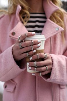 White nails, pink biker coat, stripes sweater and silver arm candy #fashionweekessentials #notforgettinghotcoffee #starbucks