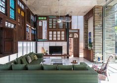 Patch work designs and a collage of recycled material come together in this uniquely constructed house sitting in Navi Mumbai's Belapur on the top of a hill overlooking Mumbai city. Created by the architecture firm S PS Architects, this private resid
