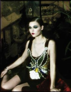 haute couture - Maison Martin Margiela  sequin-embellished corseted silk body, made to order, price on request.  Annie's Vintage silk‑chiffon 1930s teddy (worn underneath), £58. Sonia Rykiel  mirrored-leather shoes, about £550. Chanel Fine Jewellery white-gold and  diamond necklace and matching bracelet, both price on request Mayfair Gallery Chinese Qing  Dynasty lacquered screen, £9,500, and velvet cushion, £150