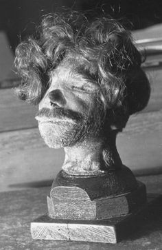 September 1946: The head of a hanged Polish man, shrunken and preserved using traditional South American methods. It was taken from an SS overseer, who used it as a paperweight. The head was listed at the Nuremberg war crimes tribunal under the heading 'Utilization of Human Material'. Picture Post - 4200 - The Greatest Trial In History - pub. 1946