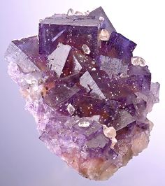 Fluorite -golden yellow interior beneath purple exteriors and with sprinkles of Calcite. From the Minerva #1 mine, Hardin County, Illinois, USA