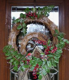 This wreath is very unique with a smaller grapevine wreath placed in a larger wreath! It measures 22 inches and features a birdhouse and two cute