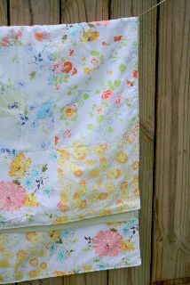 a repurposed picnic blanket.....from vintage linens.  Makes me want to head to Goodwill!