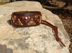 hand made leather bicep cuff/upcycled leather by longshotleather