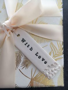 A personal favourite from my Etsy shop https://www.etsy.com/uk/listing/593814627/with-love-porcelain-gift-tag-ceramic