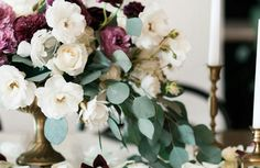 Florals in an urn type vase with lots of movement