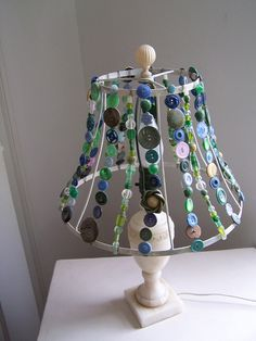 Blue buttons attached to a wire lampshade frame