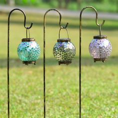 Mosaic Solar Lantern Set---multicolored glass mosaic adds an elegant glow at night; shepherd's hook stakes are included for lighting a border or a path, or simply use on a tabletop