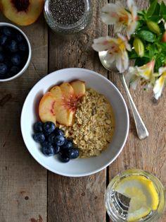 Orange overnight oats with yogurt blueberries and peach