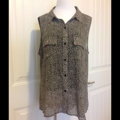 """TORRID button down in a beautiful animal print. Torrid sheer flowing top.Has two front pockets measures 26 1/2 """" top to bottom and longer in back. Torrid size 0 = womens 12 a roomy 23 1/2 """" armpit to armpit Torrid Tops Button Down Shirts"""