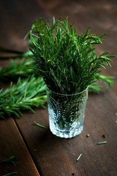Summer style! Keep herbs in pretty glasses throughout the house -- and especially in the kitchen!