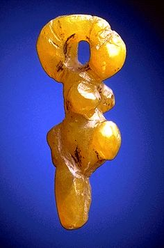 Prehistoric Goddess pendant carved from amber, from Eastern Europe