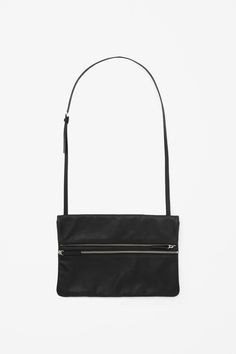 cos Made from soft, unstructured leather with a lightly grained quality, this bag is a modern foldover style with metal zip fastenings. Fully lined, it has two zip-up compartments and a large back pocket that is secured with a hidden magnet. A slim detachable leather strap means that it can also be worn as a clutch bag.