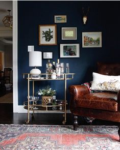 Park and Oak design Navy walls, leather chair, vintage rug