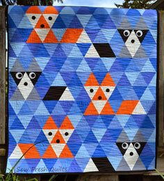 Sew Fresh Quilts: Equilateral Triangle Quilt Tutorial - I think the pattern is available for sale by this quilter, but her site also has a tutorial. So cute! But, I'd add one more row under the animals (of orange or gray), I think it would look better.