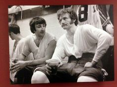 Guy Lapointe and Larry Robinson have a pre-game chat in the dressing room.
