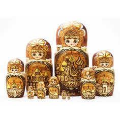 Woodburned gold ring nesting dolls