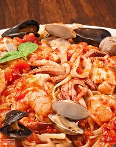 Linguine with Seafood (Linguine ai Frutti di Mare) from MyGourmetConnection ~ served over linguine, this classic dish combines shrimp, scallops, squid, tilapia, clams and mussels with a garlicky marinara sauce