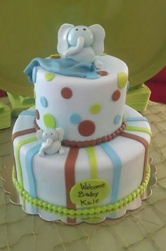 I like this elephant cake but would make the stripes & polka dots pink/blue/yellow/green.