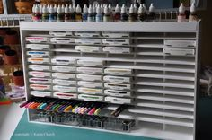 SYZYGY OF ME shows us how to make a storage system for our stamp pads out of foam board! You can find complete instructions on her blog. Ta-da! After all the shelves were in place, I glued on the ends, top, and back. The top isa shelfto hold all my reinkers.