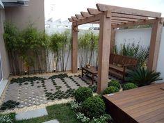 Garden built with grass, bamboo, shrub, wood deck and gazebo.