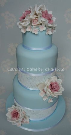 """Vintage Blue Rose & Hydrangea Wedding Cake, bottom two tiers are 6"""" deep and wrapped in sugarveil"""