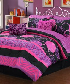 Brighten bedroom décor with a splash of fabulous fashion. Stylishly sophisticated, this comforter set offers a chic way to personalize a bed in need of a fresh makeover.