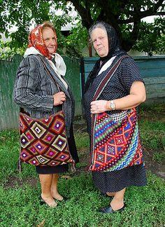 """Ukrainian Secret models wearing their """"Taistra"""", a woven pouch/wallet"""