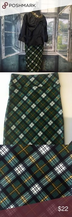 Agnes and Dora plaid pencil skirt 105 Agnes and Dora pencil skirt. I used to be a A&D rep. These skirts have a comfortable yoga waistband. Can be dressed up or down. 97% polyester and 3% spandex. Wash inside out on delicate cycle and hang to dry. Measurements taken flat and in inches. Waist 16. Hip 18. Length 25 3/4.  Colors are forest green, white, black, and a thin line of mustard yellow. Agnes & Dora Skirts Pencil
