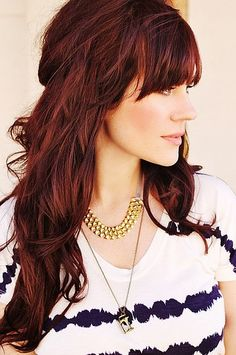 This deep red color is absolutely gorgeous. We also love how some of the hair is loosely pinned back.