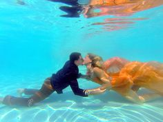 Underwater Photoshoot Photo ideas #somuchfun #underwatershoot #underwaterphotography #swimmingwithclothes #love #engaged #somethingsfishy #mermaid #frickphoto #underwater #loveunderwater #thisishowwevegas #whathappensinvegas #notmynormalcamera www.FrickPhoto.com