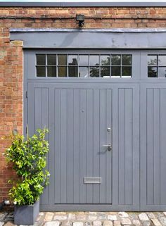 Grey carriage house door + brick