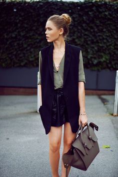 love that shade of green with black and the black vest with that top.