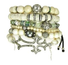 stack attack! pavé diamonds, woolly mammoth ivory, rose cut diamonds, ostrich egg beads and tahitian pearls. nanfusco.com