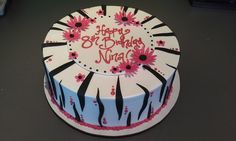 A sassy cake with zebra stripes, plaque and daisies in fondant on buttercream.