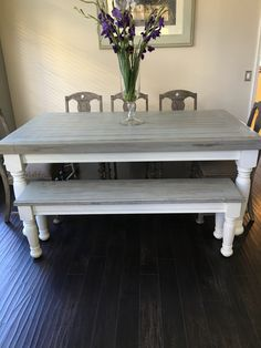 Farmhouse table with light grey base and distressed dark grey top.  4x4's and 4x6's were used to build the top.  Matching bench for more seating.