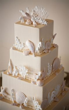 Just proves it is possible to have a beach themed wedding cake that isn't blue. This is sophisticated, appropriately colored, and beautiful.
