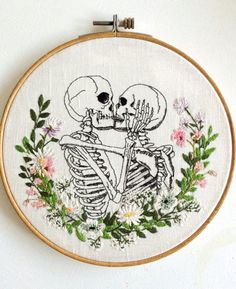This listing is for a portrait of a skeleton couple kissing with a flower wreath, hand-stitched on fabric. The piece is mounted on an embroidery hoop, and the size of the hoop is approximately 19.7 x 19.7 cm. (7.7 x 7.7)  This piece is hand stitched after one of my own illustrations, so its one o a kind. Perfect to give away to that special one as a sign of your eternal love.   Thank you for looking!  If you have any questions please contact me through etsy conversations.