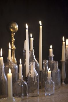 use empty (alcohol) bottles with labels removed to hold candles