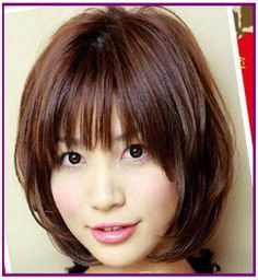 Cute short layered hairstyle.  Nice color too.