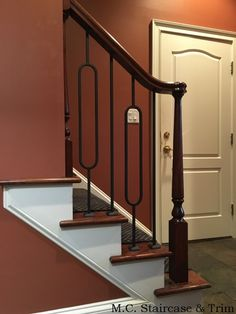 Iron baluster upgrade from M.C. Staircase & Trim. Installation of Aalto Series balusters in Satin Black.
